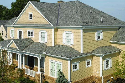 Gray Roof on large home American Standard Roofing Houston
